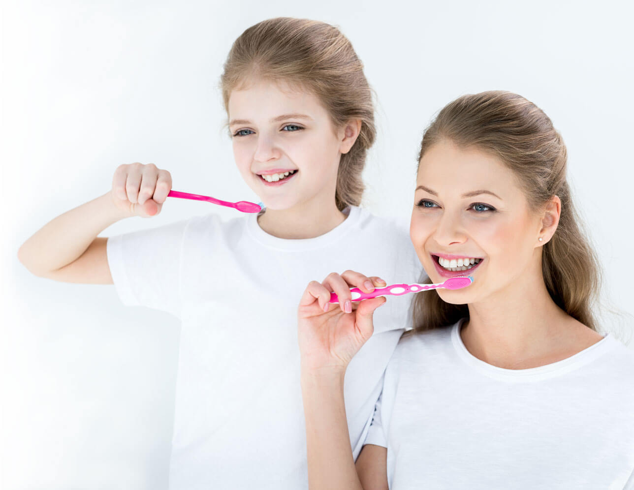 mother and daughter brushing teeth